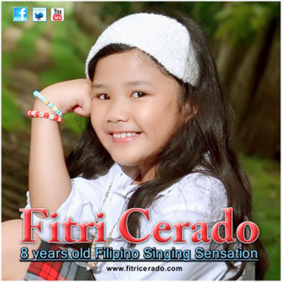 Fitri Cerado, 8 Years Old Charity Champion Sings for Other Children.  (PRNewsFoto/Toucan-Marketing UK)