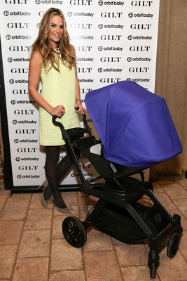 Gilt and Molly Sims celebrate the launch of the Orbit Baby G3 stroller and travel system at The Refinery Hotel Rooftop on January 28, 2014 in New York City (Photo by Neilson Barnard/Getty Images). (PRNewsFoto/Orbit Baby, Inc.) (PRNewsFoto/ORBIT BABY_ INC_)