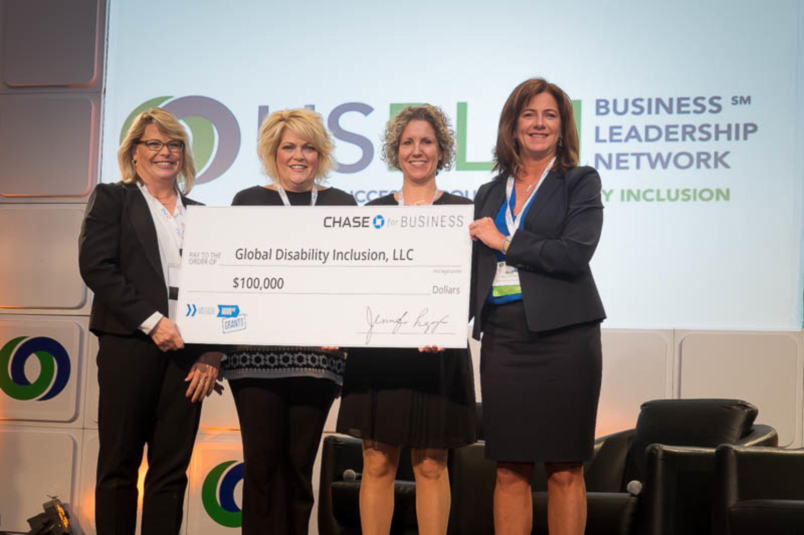 Small business wins $100,000 grant from Chase. From left to right: Deb Russell, Global Disability Inclusion, Valerie Vickers & Elizabeth Daly-Torres, JPMorgan Chase diversity Team, and Meg O'Connell, Global Disability Inclusion. Photo credit: Lawrence Roffee Photography
