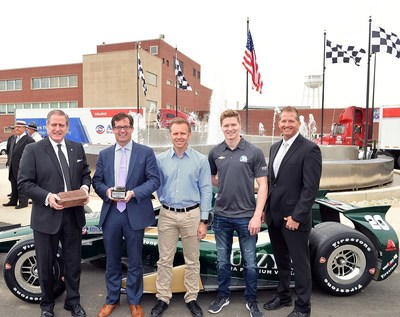 Allison Transmission and the Indianapolis Motor Speedway celebrated their shared heritage and recent centennial milestones with a ceremony to honor the 100th running of the Indianapolis 500. From left: Larry Dewey, chairman and CEO of Allison Transmission; Doug Boles, president of the Indianapolis Motor Speedway; Ed Carpenter, owner and driver with Ed Carpenter Racing; Josef Newgarden, driver with Ed Carpenter Racing; Lou Gilbert, director of North American marketing and global brand development for Allison Transmission.