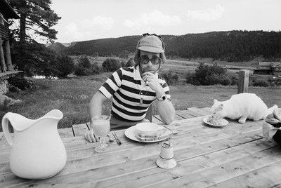 Elton John at Caribou Ranch, where he recorded three albums, with a porcelain dinner service available at auction by Leslie Hindman Auctioneers on January 24. The dinner service includes 189 items total, including the pitcher, plate and bowl pictured here. Both the indoor and outdoor furniture used in the Mess Hall and Lodge are also for sale. The Lodge is where artists such as Al Green and Billy Joel stayed while at Caribou Ranch.