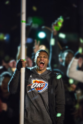"NBA star Russell Westbrook holds the ""DEWxNBA"" flag during the filming of the final scene of ""Make An Introduction,"" a Mountain Dew television spot airing in the U.S. and Canadaduring NBA All-Star 2016 featuring DEW(R) athletes and 2016 NBA All-Stars Russell Westbrook and Jimmy Butler, and rising star Julius Randle. The shoot was held in Dallas, TX on Jan. 21, 2016. (Shannon Faulk/AP Images for Mountain Dew)"