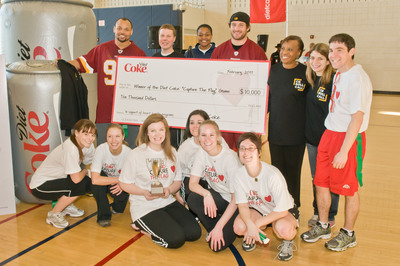 """Coca-Cola presents a check to The Links Incorporated on behalf of the winning CQ Roll Call team at the """"Capture the Flag"""" tournament. Today, Diet Coke(R)  kicked it old school and hosted the """"Capture the Flag"""" tournament in support of The Heart Truth(R) to raise awareness and funds for heart health programs in Washington, D.C. A Capitol Hill team and local D.C. media outlets competed in the tournament to win $20,000 in donations to local heart health organizations.  (PRNewsFoto/The Coca-Cola Company, Max Taylor)"""