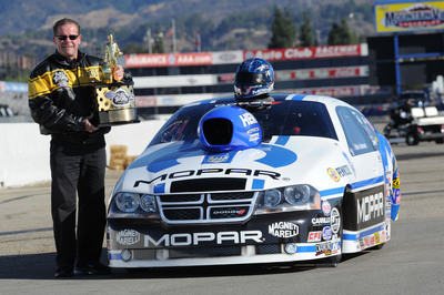 Mopar driver, Allen Johnson, his engine builder and father Roy, along with the J&J Racing team add to 75th anniversary celebrations for Mopar by winning the 2012 NHRA Pro Stock Championship at the season finale in Pomona, California.  (PRNewsFoto/Chrysler Group LLC)