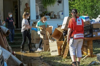 This home in Clendenin, West Virginia, flooded when the nearby Elk River overflowed its banks. People able to return home are beginning the task of cleaning up their property. The Red Cross has shelters open and is providing meals and relief supplies. Red Cross Photo by Daniel Cima.