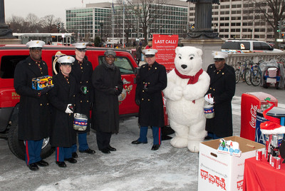 "U.S. Marines, the Coca-Coca polar bear and Curtis Etherly, Head of Public Affairs for Coca-Cola, Mid-Atlantic Region pose in front of the U.S. Marine Corps red Hummer at the Toys for Tots ""Last Call"" event at Union Station on December 16, 2010. Earlier this month, Coca-Cola launched its fourth year as a national partner of the U.S. Marine Corps Reserve Toys for Tots Program by giving a national $120,000 donation.  (PRNewsFoto/The Coca-Cola Company, Gustavo Gargallo)"