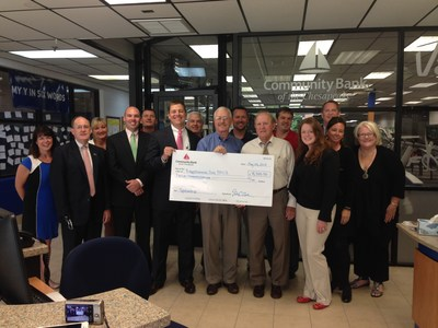 Representatives from the Rappahannock Area YMCA and Board of Directors accept the donation check presented by Community Bank of the Cheaspeake. (PRNewsFoto/Community Bank of the Chesapeake)