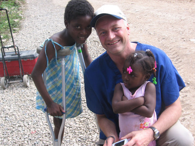 Michael Maron, President/CEO of HNMC, with children in Milot, Haiti.  (PRNewsFoto/Holy Name Medical Center)