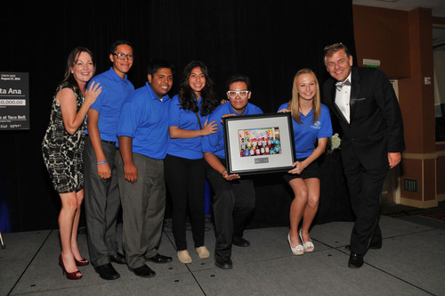 Amy Kavanaugh, Taco Bell(R) Vice President of Public Affairs and Engagement (far left) and Frank Tucker, Taco Bell(R) Chief People Officer (far right) are joined by members of their team to accept the Boys and Girls Club of Santa Ana's DreamMaker ...
