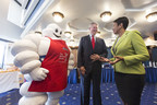 DC Mayor Muriel Bowser and Michelin CEO Pete Selleck are greeted by the Michelin Man at a press conference announcing the arrival of the Michelin Guide to Washington, DC at the National Press Club, May 31, 2016.