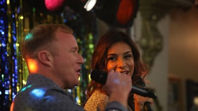 Ex-Corrie stars Shobna Gulati and Steven Arnold get together in cracking Karaoke ad for GalaBingo.com! (PRNewsFoto/Gala Interactive)