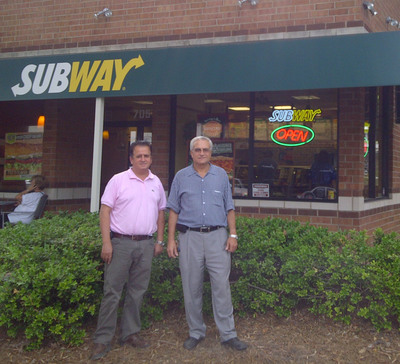 "Franchisees and brothers, Burhan and Marwan Ghanayem, stand in front of their new ""Eco"" SUBWAY(R) restaurant in Durham, NC, which has been recognized by the U.S. Green Building Council with Leadership in Energy and Environmental Design (LEED) certification. There are now 14 ""Eco"" SUBWAY(R) restaurants in the U.S. Additionally, many other SUBWAY(R) franchisees are incorporating ""eco"" elements into their own restaurants.  (PRNewsFoto/SUBWAY Restaurants)"