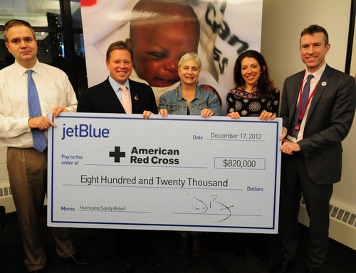 JetBlue executives were joined by two customers to present $820,000 to the Red Cross for Hurricane Sandy relief efforts in the New York metro area. Customers Niki Glarkis and Rosalind Sutherland represented the more than 7,400 JetBlue customers and TrueBlue members that generously gave through JetBlue's Sandy relief donation site - JetBlueGives.org.   (l to r) Robin Hayes, JetBlue's chief commercial officer, Rob Maruster, JetBlue's chief operating officer, JetBlue customers Niki Glarakis and Rosalind Sutherland and Josh Lockwood, ...