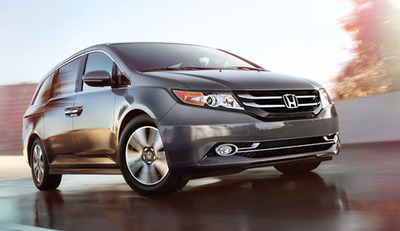 The 2014 Honda Odyssey truly has families in mind with the addition of a self-contained vacuum cleaner that can help busy parents keep their minivan as clean as possible. Also the Spreen Honda Service Department reminds people to have regular transmission flushes.  (PRNewsFoto/Spreen Honda)