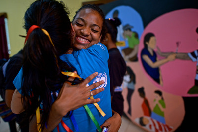 UNICEF Ambassador Angie Harmon hugs a youth leader who works with her peers on issues affecting adolescents in Bluefields, Nicaragua. (PRNewsFoto/U.S. Fund for UNICEF, Kike Calvo / Courtesy of the U.S. Fund for UNICEF)