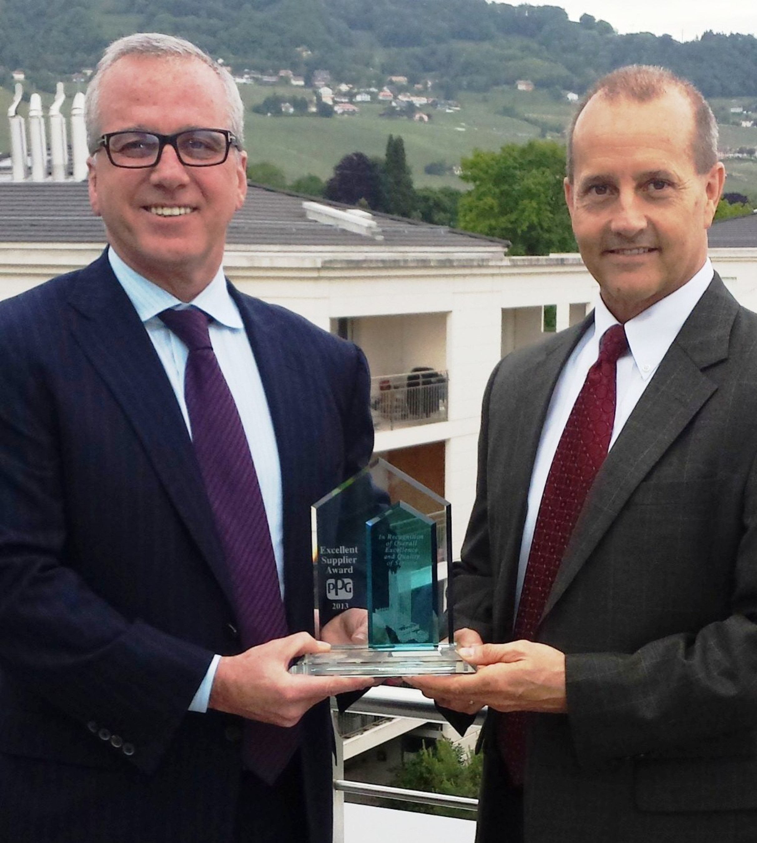 GEO's President and CEO Kenneth A. Ghazey (l) receives the Excellent Supplier Award from Gary Danowski, Vice President, Automotive Refinish, EMEA, PPG. (PRNewsFoto/GEO Specialty Chemicals, Inc.)