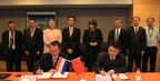 ASML's Sr. Vice President WW Field Service, Mr. Chi Yu (front left) and SMIC's Vice President, SPM and Planning, Mr. TH Chen (front right) formally signs the VPA agreement between SMIC and ASML. SMIC's CEO Dr. T.Y. Chiu (third from far right) and Minister Lilianne Ploumen (fourth from far right) were also present at the signing ceremony.