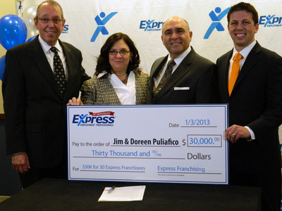 Don Lapp, Northeast Zone Vice President for Express Employment Professionals (left) and David Lewis, Vice President of Franchising for Express Employment Professionals (right), presenting new franchisees Doreen & Jim Puliafico with $30,000 in working capital as part of their 30 for 30 campaign.