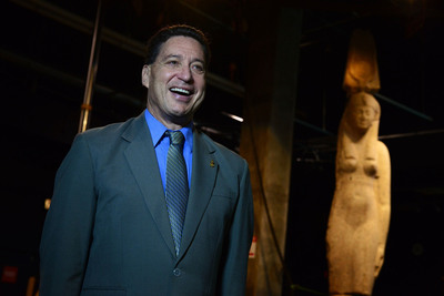 "Installation of the west coast premiere of ""Cleopatra: The Search for the Last Queen of Egypt"" began at the California Science Center on May 9, 2012 with a 16-foot, 4-ton red granite colossal statue of a queen. Standing beside it is Science Center President Jeffrey Rudolph. Dated to Cleopatra's dynasty more than 2,000 years ago, the statue was recovered from the ancient submerged city of Heracleion near Alexandria, Egypt by underwater archaeologist Franck Goddio and team. The Cleopatra exhibition opens May 23, 2012.  (PRNewsFoto/California Science Center, Leroy Hamilton)"