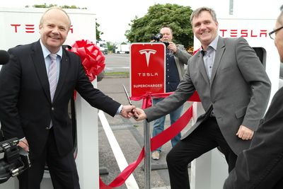 State Secretary, Dr. Klaus Klang (left), Johannes Witt, Managing Director, Euro Rastpark GmbH & Co. KG (right) (PRNewsFoto/Tesla Motors)