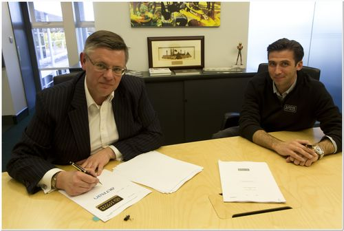Mike Simms, CEO of Altran UK, and Matthew Carter, CEO of Lotus F1 Team, signing the Technical Partnership ...