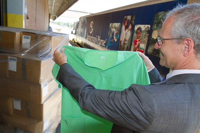 PurThread Technologies' Medical Director, Dr. Russ Greenfield, oversees the donation of medical scrubs and privacy curtains to Samaritans Purse. (PRNewsFoto/PurThread Technologies)