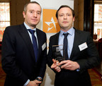 Matthew Brown (right), Executive Director of DMS Offshore Investment Services (Europe), receives the award from Hedgeweek's editor, James Williams.