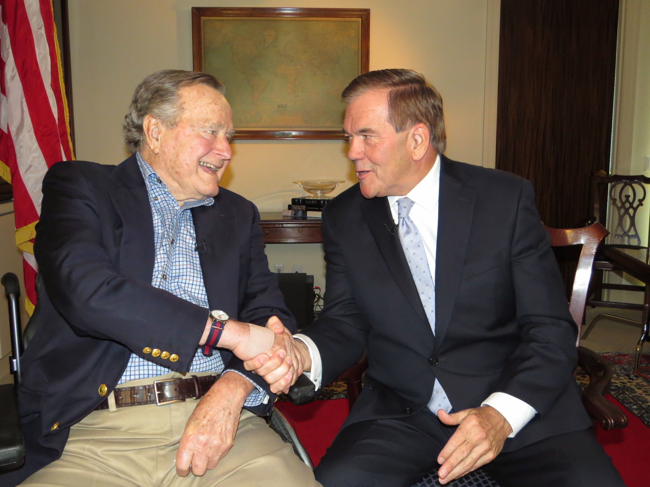 President George H.W. Bush, Honorary Chairman of the National Organization on Disability, shaking hands with Tom Ridge, Chairman of the National Organization on Disability.