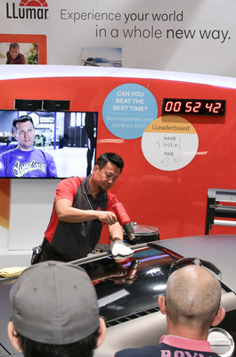 Daniel Chong, LLumar Technical Specialist, sets the time to beat in the LLumar window tint installation challenge, on a West Coast Customs Audi R8.