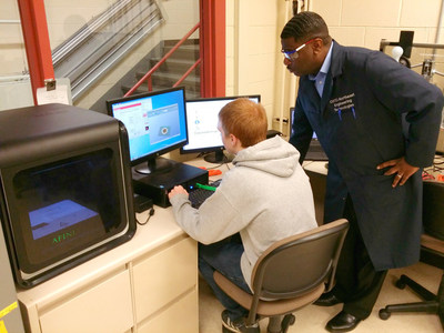 Demetrius Wilson, instructor at Oakland Schools Technical Campus Northeast in Pontiac, Michigan, works with students to learn about the Afinia 3D printer given by SME.