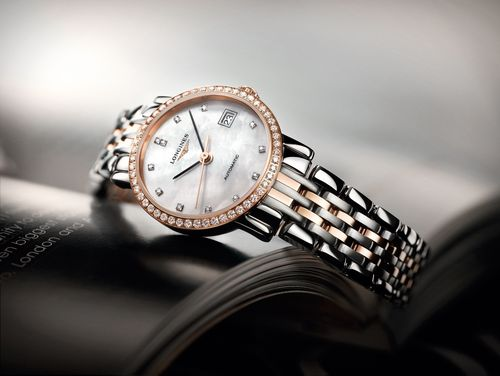 The Longines Elegant Collection is the perfect embodiment of the classical design and sleek lines typical of Longines timepieces. With a diameter of 25.50, this model in steel and rose gold cap is set with 52 diamonds and displays a white mother-of-pearl dial with diamond indices. It is fitted with the self-winding mechanical movement L595. (PRNewsFoto/Longines)