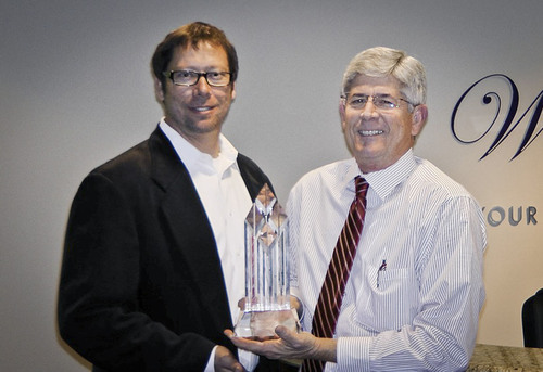 "Panasonic is honored with ""Supplier of the Year"" Award for its leadership in 3D technology by national cable network WealthTV.  (L) Robert Herring, Jr, VP of WealthTV.  (R) Tommy James, Sr. Area Sales Manager of Panasonic.  (PRNewsFoto/WealthTV)"