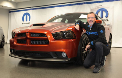 """Mopar President and CEO Pietro Gorlier unveiled the Dodge Charger Juiced, one of 24 Mopar-modified vehicles that will be displayed during the 2012 Specialty Equipment Market Association (SEMA) Show in Las Vegas later this month. Dodge Charger Juiced is a modern-day take on a custom street rod, mated with an emissions-friendly Viper V-10 Mopar crate engine and an array of Mopar parts and accessories.  Dodge Charger Juiced demonstrates what the average Charger owner can create. Juiced features a Mopar front chin spoiler, a matte version of the custom Metallic """"Copperhead"""" paint, hood and decklid graphics and Mopar-exclusive 20-inch lightweight wheels trimmed in matte black.  (PRNewsFoto/Chrysler Group LLC, Joe Wilssens photo)"""