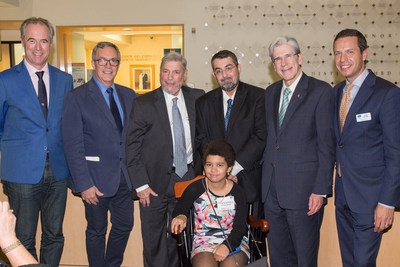 At the ceremony for the presentation of the J. Enloe and Eugenia J. Dodson Chair in Diabetes Research, speakers, including Bart Roep, M.D., Ph.D., Camillo Ricordi, M.D., Laurence B. Gardner, M.D., MACP, Alberto Pugliese, M.D., President Julio Frenk, and Joshua Rednik, pause for a photo, while Valentina Pugliese tries out her father's chair.