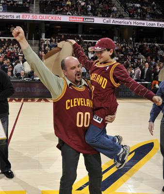"Daniel Carbo and son, Alex, of Colchester, Connecticut, just learned they were the grand prize winner of the Quicken Loans ""Thanks a Million"" contest.  Quicken Loans paid off the Carbo's mortgage to recognize the company's closing of its one millionth loan.  (PRNewsFoto/Quicken Loans Inc.)"