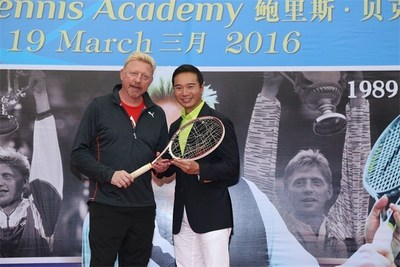 Tennis legend Boris Becker (left) gives the racket he won Wimbledon tournament in 1985 with to Mission Hills Vice Chairman Tenniel Chu during the press conference for the opening of Boris Becker Tennis Academy at Mission Hills Resort on 19 March 2016, in Shenzhen, China.