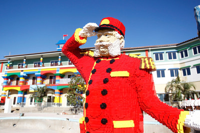 """A LEGO(R) Bellhop greets guests in front of nation's first LEGOLAND(R) Hotel at LEGOLAND(R) California Resort kicking off a national Junior Concierge search. LEGOLAND Hotel is searching the nation for six children ages 8 - 12 who will train and serve as Junior Concierges after the Hotel opens April 5, 2013. Interested applicants visit www.LEGOLAND.com/JuniorConcierge. Also announced, 2013 expansion plans including new animated 4-D movie """"LEGO Land of Chima"""" and a LEGO(R) Star Wars(R) addition arriving in June. (PRNewsFoto/LEGOLAND California Resort) (PRNewsFoto/LEGOLAND CALIFORNIA RESORT)"""