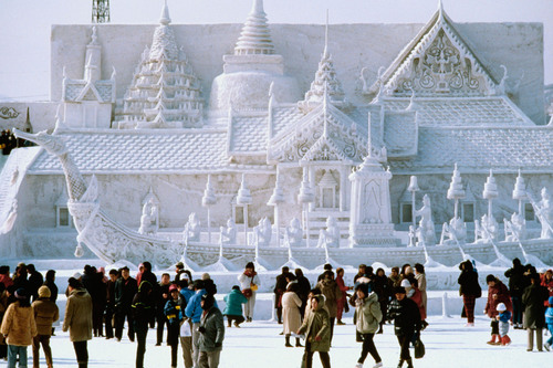Tourists flock to the snow sculpture of Bangkok's Royal Palace at the Snow Festival in Sapporo, Japan.  ...