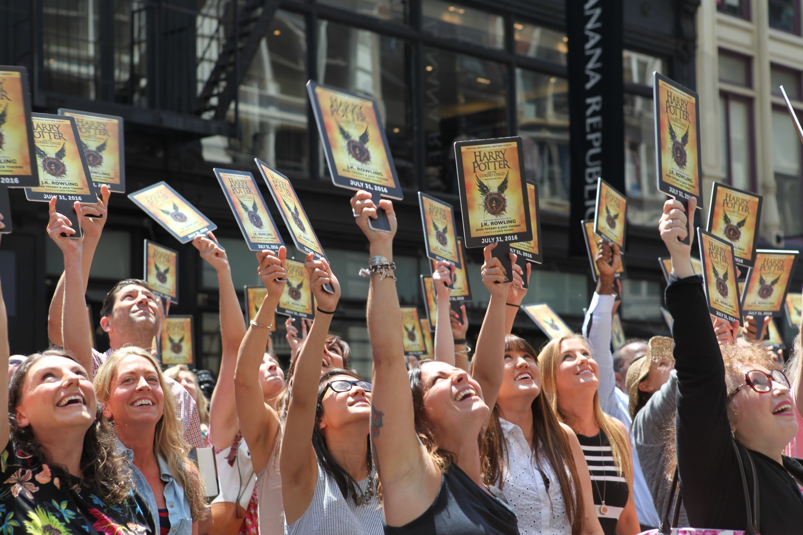 """On July 21, a """"Muggle Mob"""" of 300 Harry Potter fans fills the street in front of the Scholastic headquarters building in New York City to celebrate the upcoming release of """"Harry Potter and the Cursed Child Parts One and Two,"""" the eighth story, on July 31, 2016 at 12:01 a.m. ET. Credit: Scholastic"""