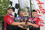 Colt Morris, Instructor Carl Hader and Justin Bublitz from Grafton High School in Grafton, Wis. celebrate after winning the National Championship at the 65th Annual Ford/AAA Student Auto Skills Competition on June 10, 2014 at Ford World Headquarters in Dearborn, Mich. (PRNewsFoto/AAA)