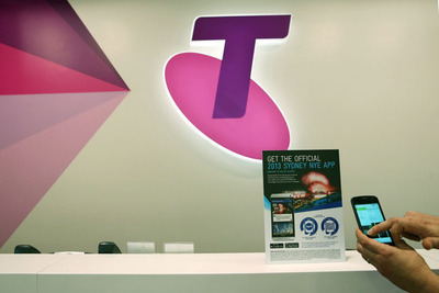 Tapit enables Telstra Point of Sale materials, just tap to install the New Years Eve app.  (PRNewsFoto/Tapit Media Pty Ltd)