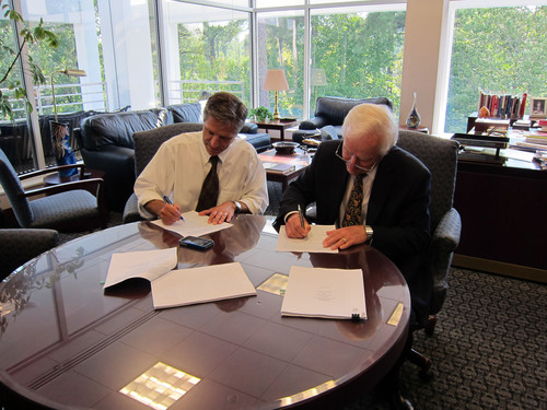 Steve Arms, MicroStrain & Rick McNeel, LORD sign deal.  (PRNewsFoto/LORD Corporation)