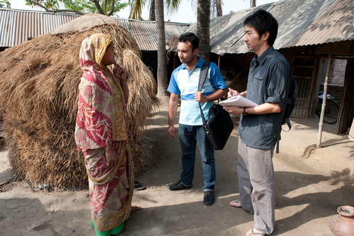 Daigo Ishiyama (right), an industrial designer with American Standard Brands, interviews a villager in ...