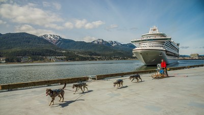 A dog sled team led by Maliko Ubl from the TEMSCO Helicopters Mendenhall Glacier Dog Sledding Tours and Alaska Icefield Expeditions welcomed Ruby Princess to the port of Juneau during her maiden voyage in Southeast Alaska.