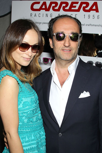 Actress Olivia Wilde and Roberto Vedovotto, CEO of Safilo Group, wearing Carrera sunglasses at the Carrera Ignition Night event in New York City.  (PRNewsFoto/Safilo Group)