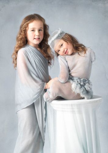 Amber, five, from Croxteth, Liverpool, is the youngest child to be photographed by Anne Geddes. Amber lost her legs and arms after contracting the disease aged two. She is pictured with her sister Jade. (PRNewsFoto/Novartis)