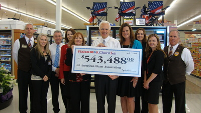 "Stater Bros. President and COO, Pete Van Helden (center) presents a $543,488 check to the American Heart Association & American Stroke Association representing funds raised during the recently concluded ""Have a Heart, Save a Heart"" in-store fundraising campaign. The check presentation was held at the Stater Bros. Supermarket in Big Bear, which is the Stater Bros. store that raised the most money for the campaign this year."