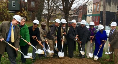 Members of the community, including Congressman Fattah's staff, join in the groundbreaking celebration of the Centennial Village project in the Parkside neighborhood of Philadelphia.