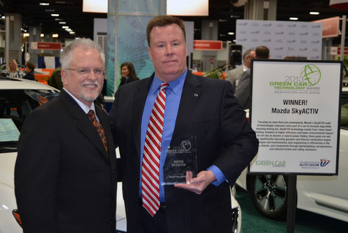 Ron Cogan, editor, Green Car Journal, presents award to Peter Donnelly, regional general manager, Mazda North American Operations.  (PRNewsFoto/Mazda North American Operations)