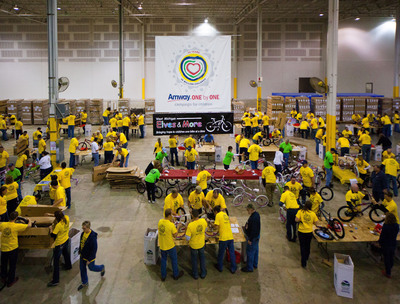 Amway World Headquarters employees partnered with Elves & More to assemble 1,400 children's bicycles that will be distributed during the upcoming Christmas season.  (PRNewsFoto/Amway)